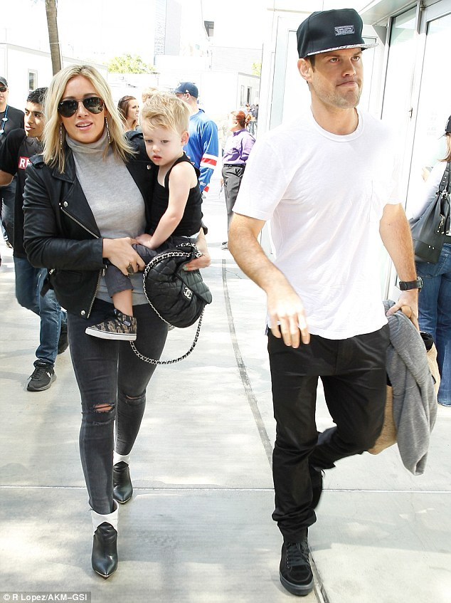 Happy families? Hilary Duff and estranged husband Mike Comrie put their separation behind them on Saturday to attend the Los Angeles Kings hockey game together with their son Luca