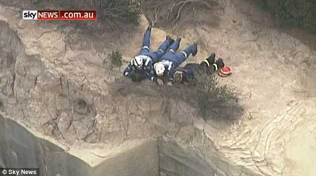 Two police rescue officers abseiled down the cliff to retrieve the body on Sunday night