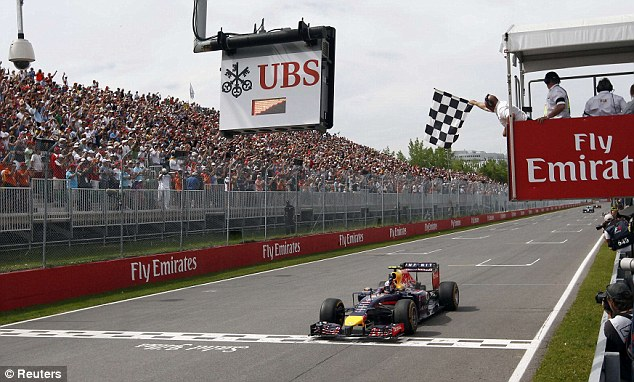 Winning moment: The Australian comes home to take the chequered flag in Montreal