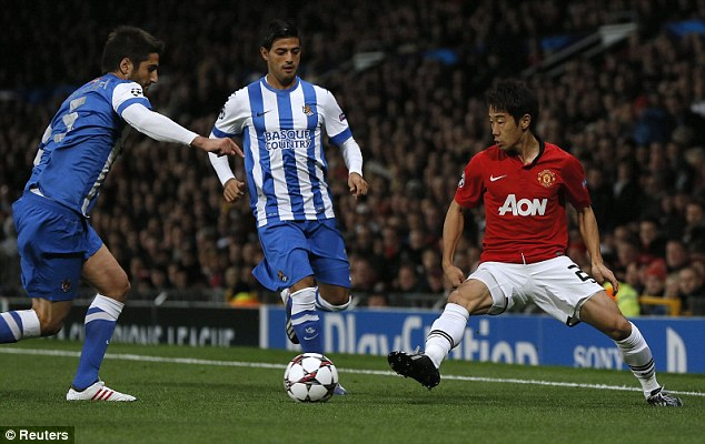 Buy-back: Real Sociedad want Arsenal to give up their 50 per cent stake in striker Carlos Vela (centre)