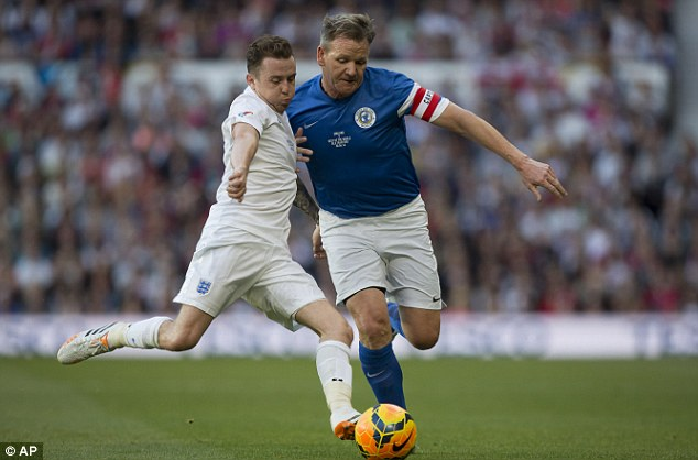 Tussle: McFly's Danny Jones (left) battles for the ball with Gordon Ramsey