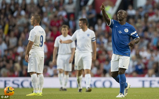Star man: AC Milan manager Clarence Seedorf (right) celebrates after scoring his first goal against England