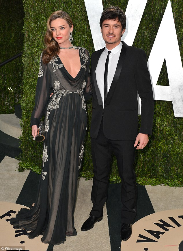 Still good friends: Orlando Bloom is still close with his estranged wife Miranda Kerr, pictured here at the Vanity Fair Oscar party in February 2013, with whom he has a son named Flynn