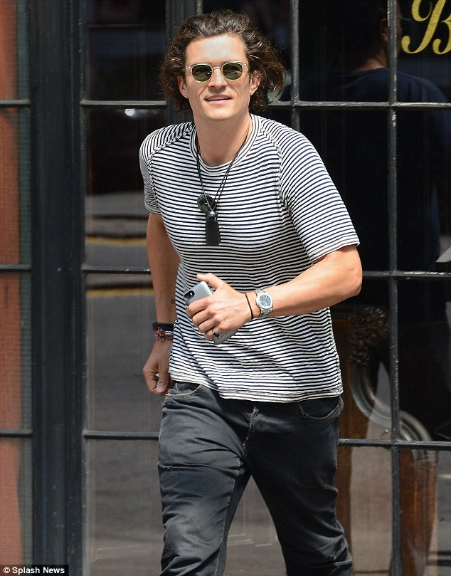In a hurry? The 37-year-old actor looked a little behind schedule in his stylish striped T-shirt and shades