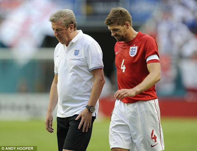 Talking things through: Steven Gerrard and Hodgson talk about the game as they leave the pitch