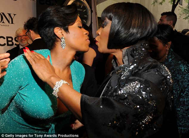 Air kisses: Patti made sure not to smudge her make-up as she greeted Fantasia Barrino at the bash