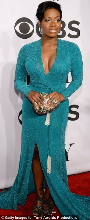 Taking the plunge: Former American Idol contestant Fantasia Barrino opted for a cleavage baring floor length gown