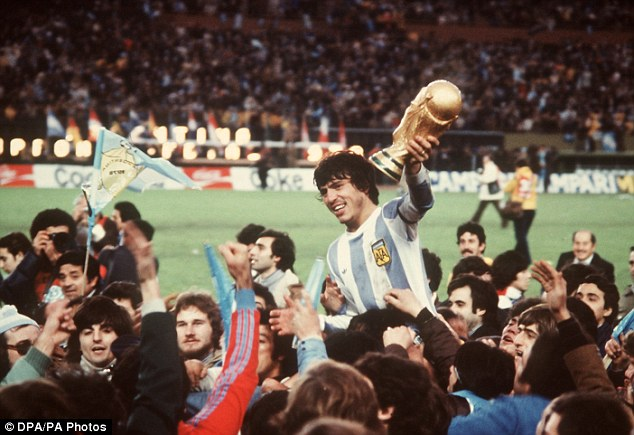 History repeated: Argentina captain Daniel Passarella holds aloft the trophy after winning the 1978 World Cup