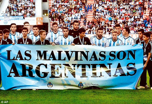 Making a statement: Argentina players unfurled a banner claiming the Falklands as theirs during a friendly with Solvenia in La Plata