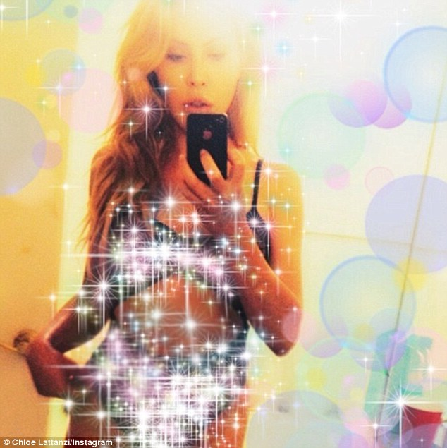 All that glitters: Chloe Lattanzi snaps a selfie on Monday of her wearing a cut out swimsuit with a glittery app, she captioned it, 'chloelattanzi Sparkle princess #I wish #this should be real'