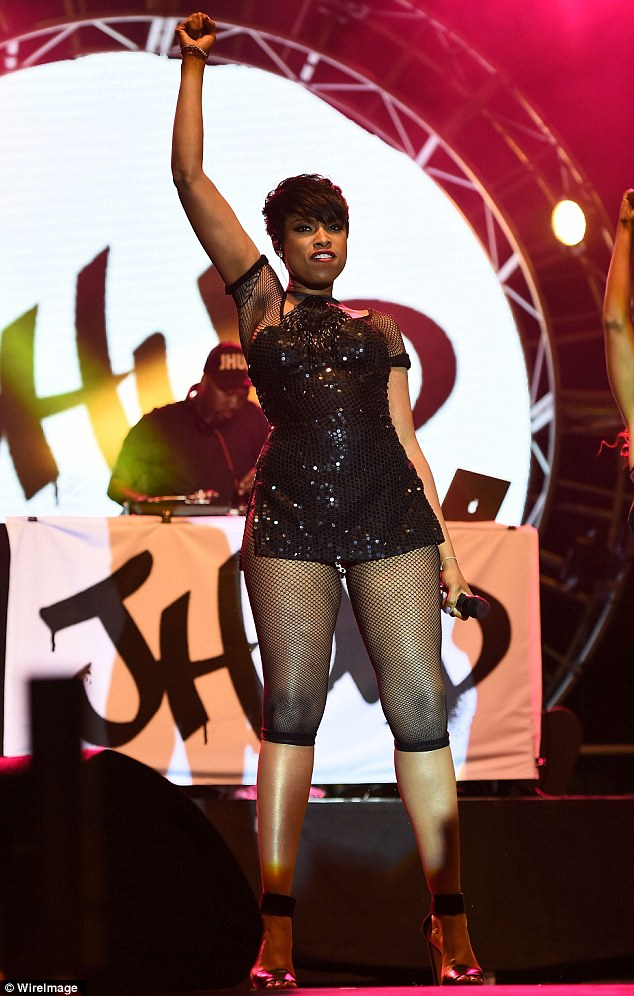 Sparkling: Jennifer Hudson wore a sequined black mini dress and fishnet bodysuit to perform at LA Pride 2014 in West Hollywood, California on Saturday