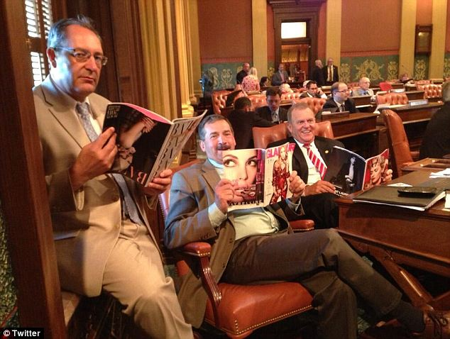 Michigan state House Republicans Peter Pettalia, Roger Victory, and Ben Glardon posed with women's magazines to prove they care about their female constituents