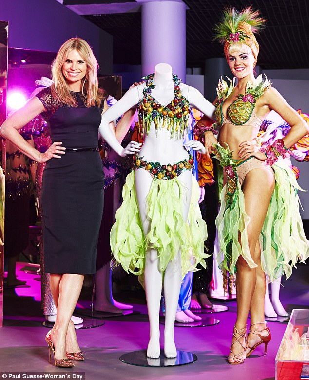 Reunited: Sonia Kruger is reunited with the infamous 'fruit suit' costume which helped shoot her to fame