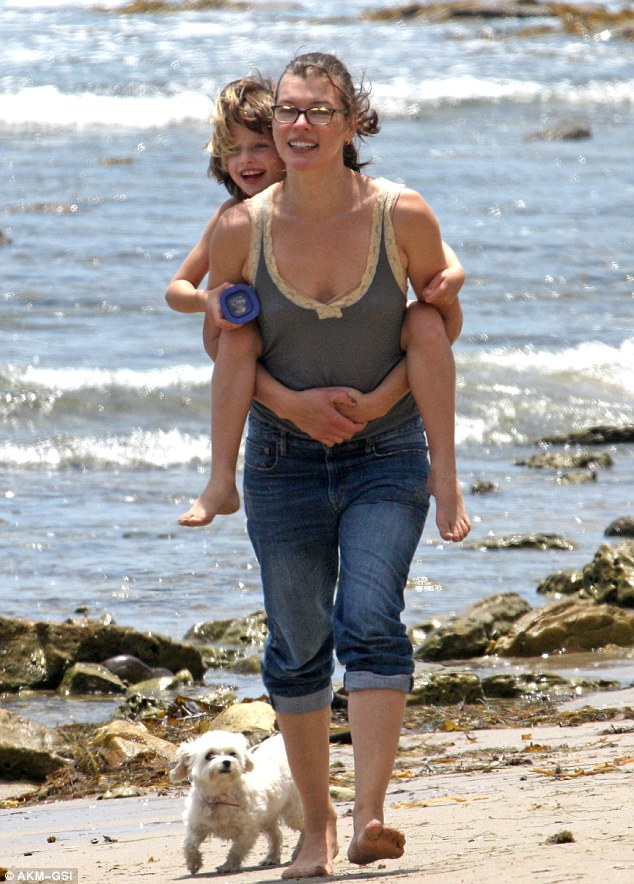 Weee! Make-up free Milla Jovovich gave her daughter Ever a piggyback during a picturesque family outing on Malibu beach Sunday
