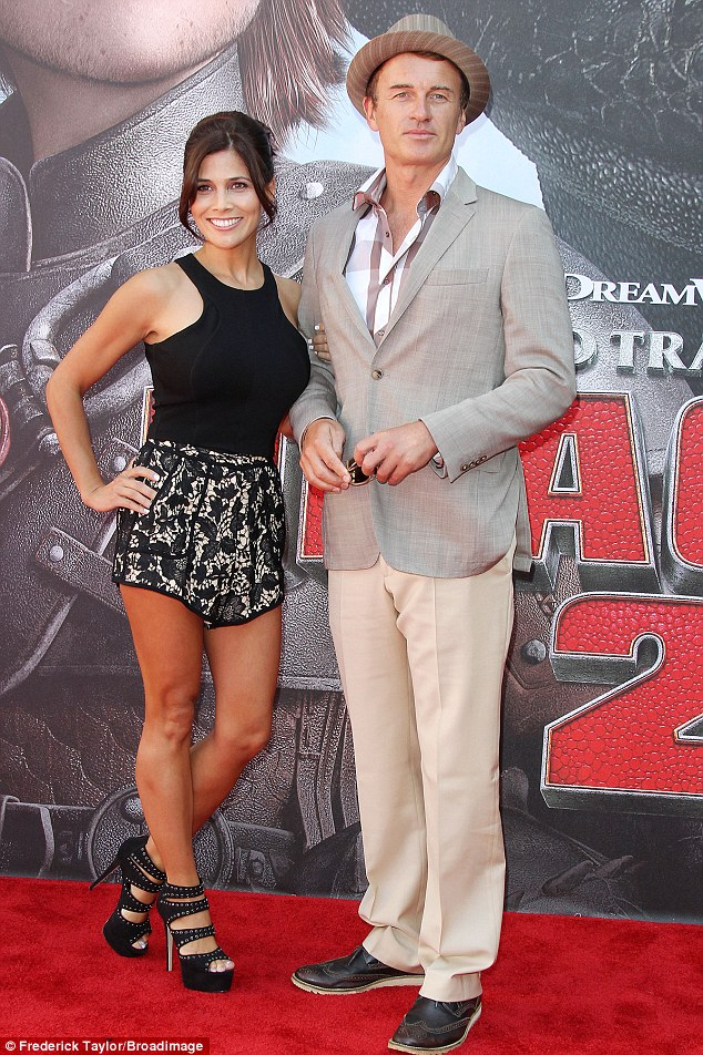 Close: Australian actor Julian McMahon and fiance Kelly Paniagua appeared every inch the loved-up couple, rarely leaving each other's sides, at the How to Train Your Dragon 2 premiere in Los Angeles on Sunday