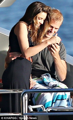 Capturing the moment: The supermodel and her handsome companion took several takes as they tried to get the perfect shot aboard the luxury cruiser on May 18