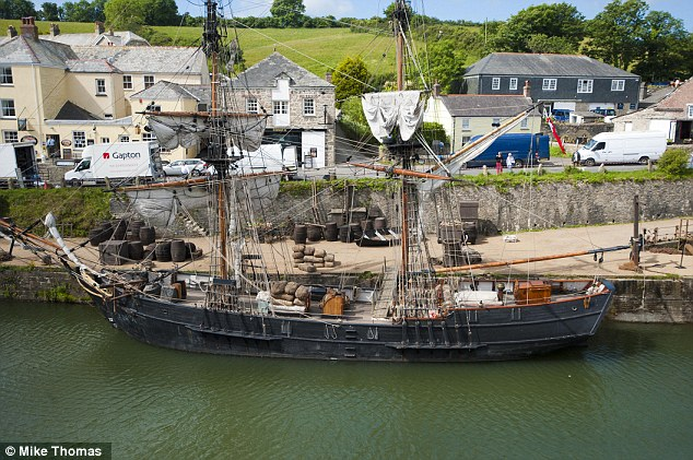 Impressive: An 18th century boat provided a focal point on the set in Charlestown near St. Austell in Cornwall on Monday