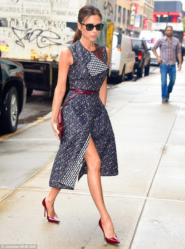 Coordinated: The designer added a red belt, pair of heels and clutch bag to complete the look