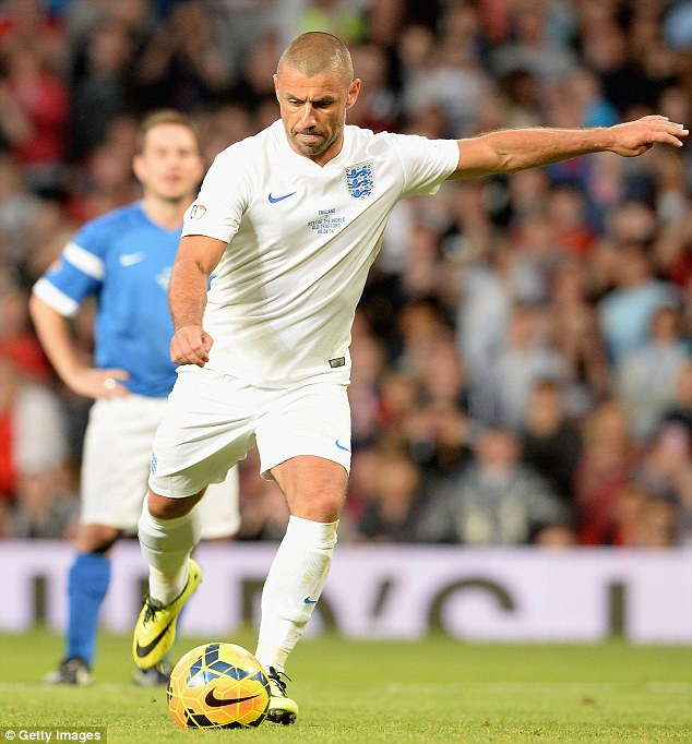Spot on: Kevin Phillips drilled home a penalty to bring England level at 2-2 late in the game