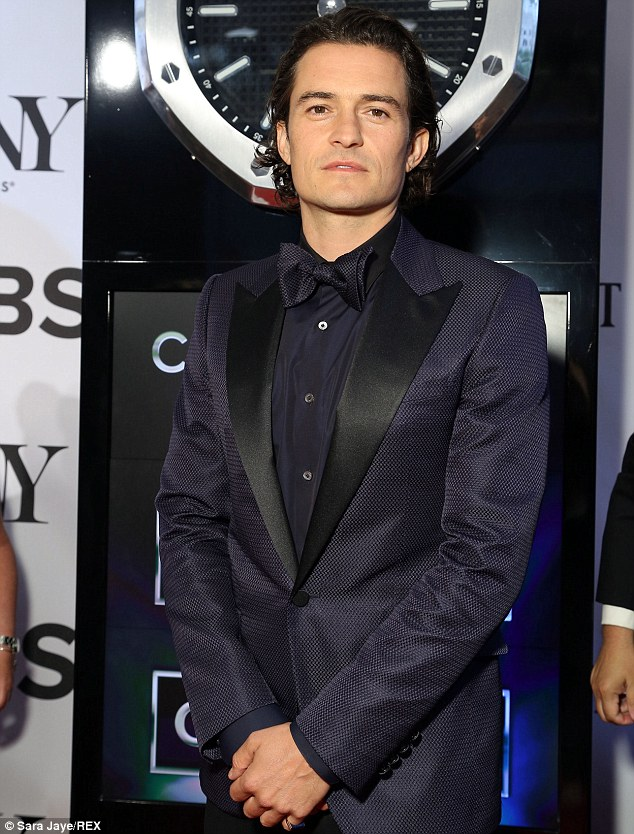 Stylish outfit: Orlando looked dapper in his dark tuxedo