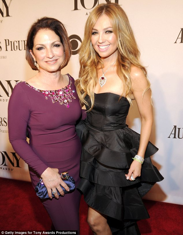 What's her secret? Gloria Estefan looked younger than ever as she took to the carpet in a slim fitting wine coloured dress alongside Thalia