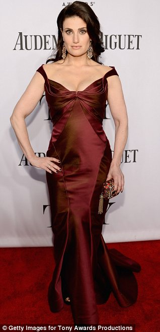 No one will be flubbing her name tonight: Idina Menzel revealed her hourglass figure in a stunning burgundy dress at the Tony Awards in New York on Sunday