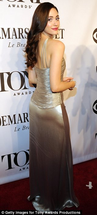 Metallic beauty: Emmy Rossum shimmered in a silk dress which showed off her slim figure to perfection
