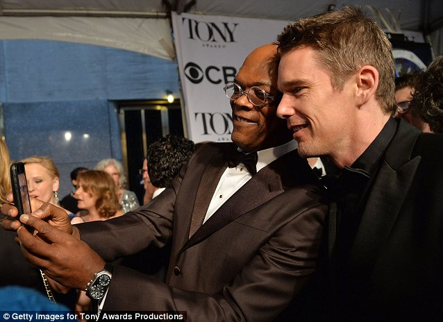 He can't stop: Samuel also stopped to take a picture of himself and Ethan Hawke as he went selfie crazy