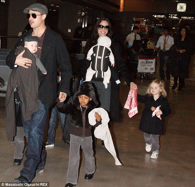 Big family: Angelina and husband Brad Pitt are shown with their children at an airport in Japan in 2009