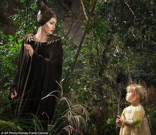 Acting debut: Angelina Jolie as title character Maleficent stares down at her daughter Vivienne playing a Young Aurora