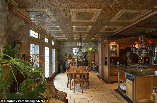 Restored: Owner Faith Schwartz hand-painted the tin ceilings in the kitchen