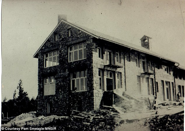 Looking back: The home can be seen in its construction phase in this photograph