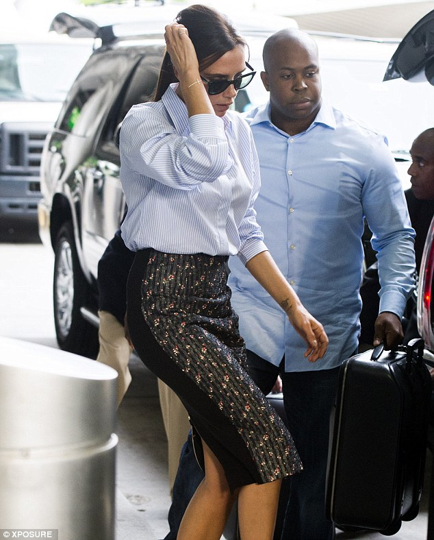 Back in business: The designer looked as slim as ever as she arrived solo in the big city