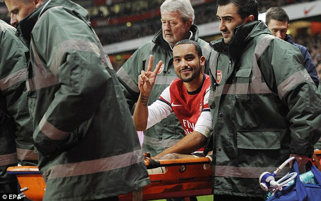 Gesture: But this injury ruled Theo Walcott out of England's World Cup campaign
