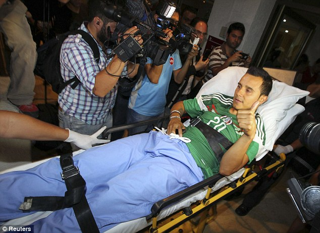Wrapped up: Mexico star Luis Montes arrives at hospital after the broken leg that scuppered his World Cup