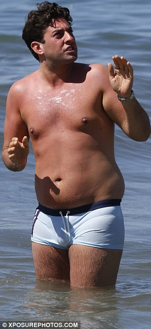 His serious face: Arg appeared to be chatting to someone while stood in the water