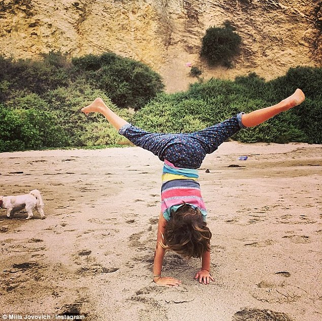 'Happy Sunday everyone! Hope you're all having a good one!' Milla - born Milica Jovovi¿ - later shared an Instagram snap of her darling daughter doing an impressive handstand in the sand