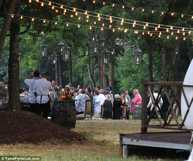 Romantic country wedding: Lanterns and tea lights during the outdoor nuptials created a memorable look