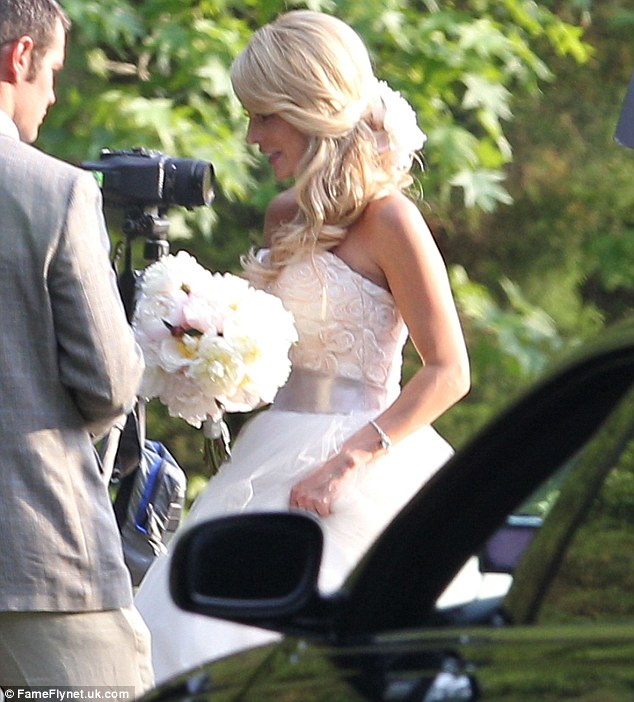 Beautiful bride: Emily Maynard from The Bachelor and Bachelorette, wed Tyler Johnson in a stunning strapless gown on Saturday in South Carolina