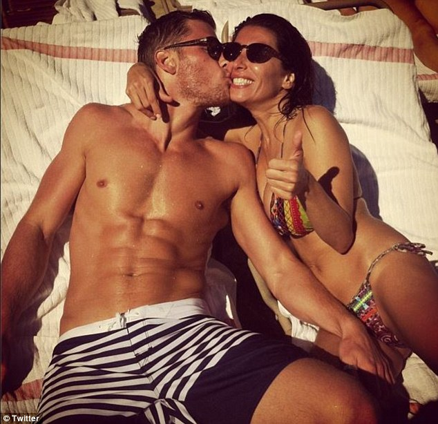 Cosy: Simon Cowell's stunning ex- fiancée Mezhgan Hussainy enjoys a sun-soaked afternoon with young lover, French-Canadian model Philippe LeBlond