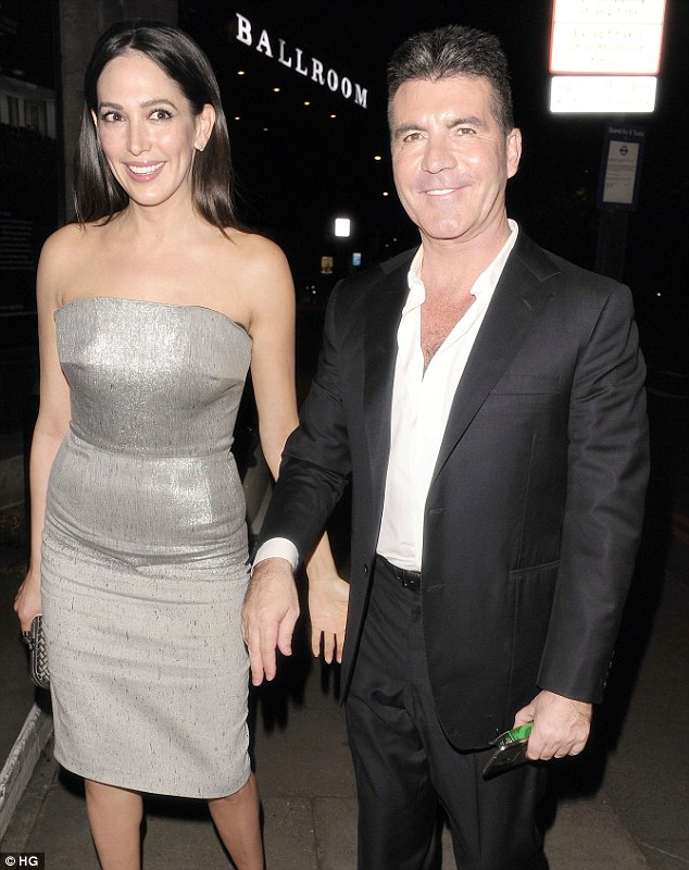 Parents: Cowell and girlfriend Lauren Silverman became parents to baby Eric on Valentine's Day. They are seen at the final of Britain's Got Talent in London on Saturday night