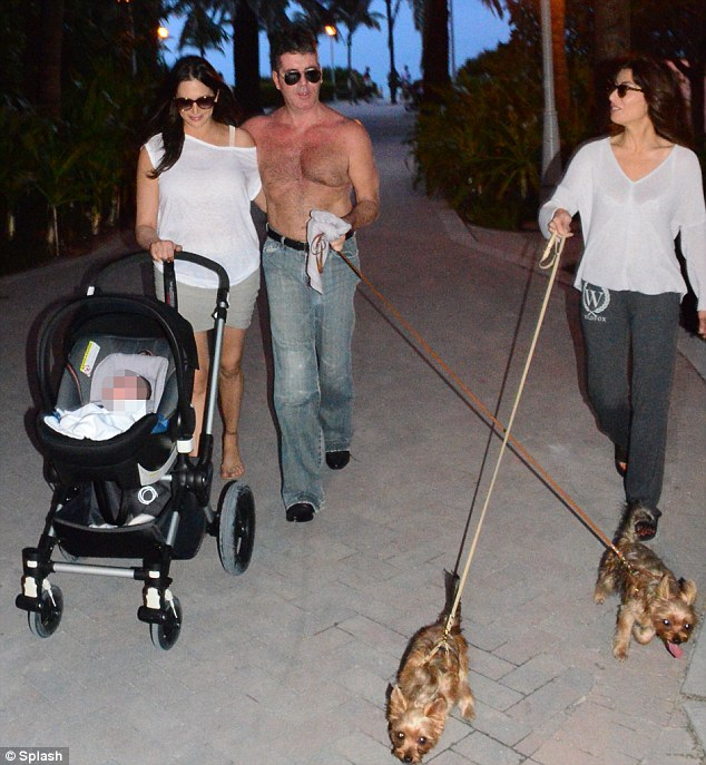 One big happy family: Mezghan remains close to Cowell and joined him, Lauren Silverman and their newborn son Eric, alongside dogs Squiddly and Diddly, in Miami shortly after the baby's birth in February.