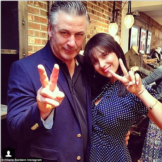 Matching in blue: Hilaria in a rare non-yoga Instagram photo with husband Alec Baldwin, 56, on June 1