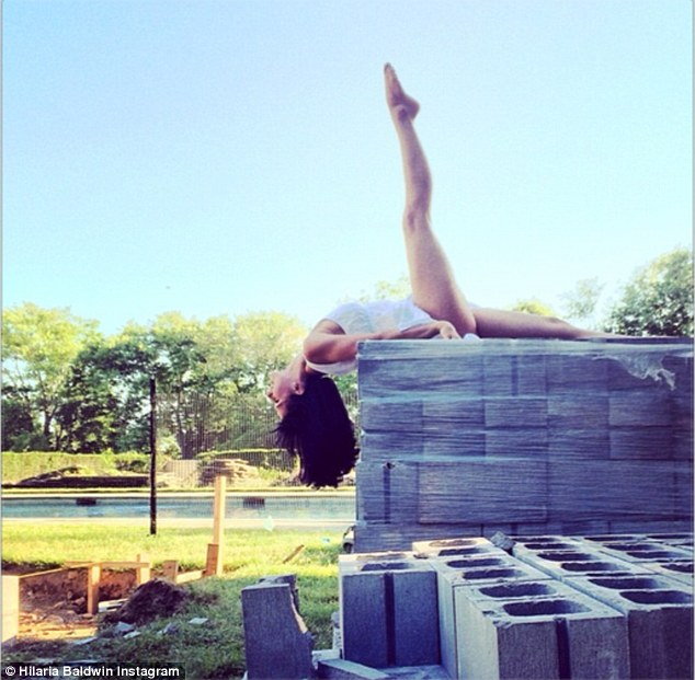 Construction zone: Hilaria shared with fans a look at her variation of the supta padangusthasana pose as she is seen 'Reaching for the sky & constructing new ideas' on Sunday June 8