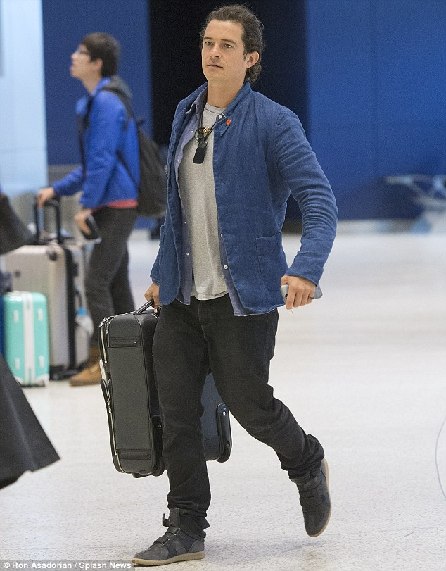 Old flame: Miranda's ex-husband and the father of her son Flynn, Orlando Bloom, was seen arriving at JFK on Monday