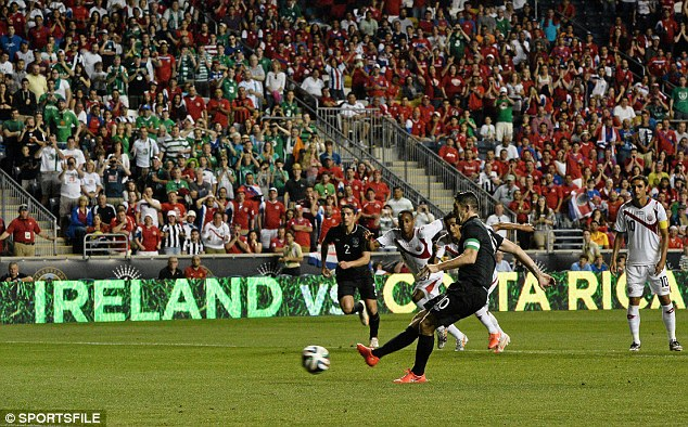 Uncharacteristic: Robbie Keane is not overly upset by his penalty miss for Ireland against Costa Rica
