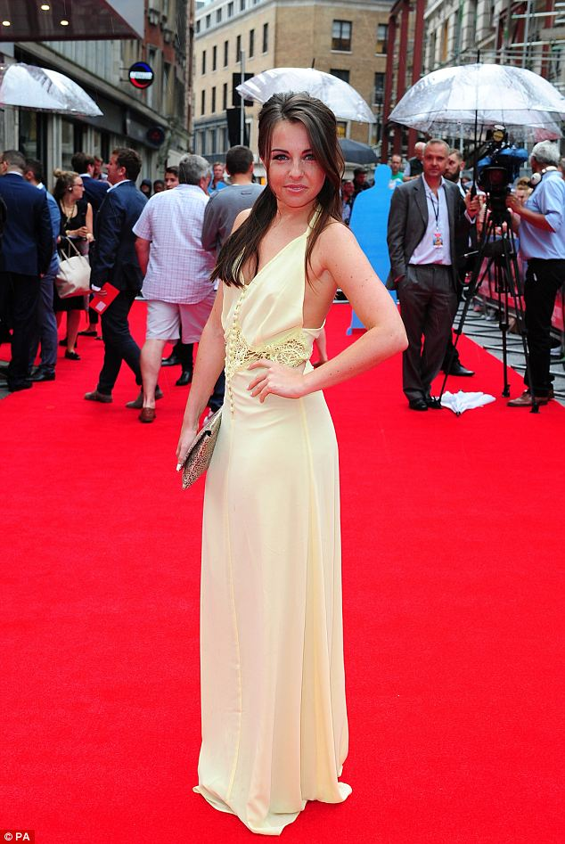 Glamorous: The former EastEnders star looked at ease as she posed on the red-carpet