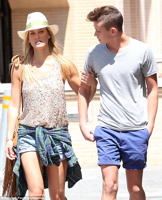 Tight bond: Bar kept her hand wrapped around her brother's arm as they took a sunny stroll