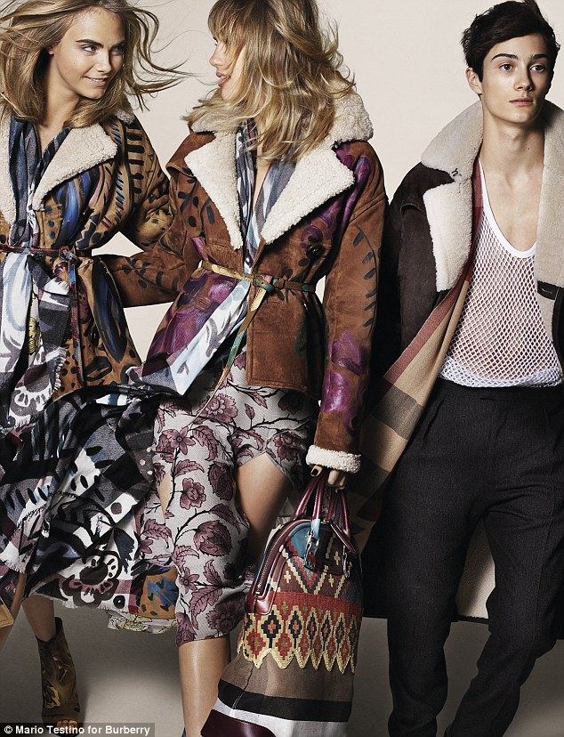 Work hard, play hard: Party loving models Cara Delevingne and Suki Waterhouse are helping showcase the AW14 Burberry range (and newcomer Oli Green is repping the men)