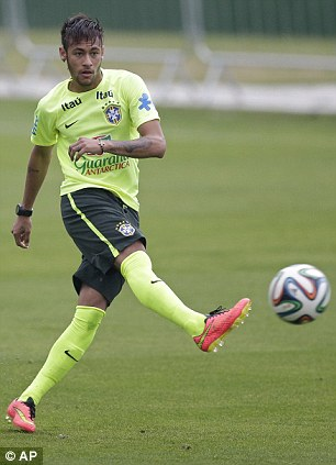 Neymar practices during a training session
